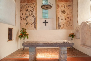 The chancel, stone altar slab, and wall paintings