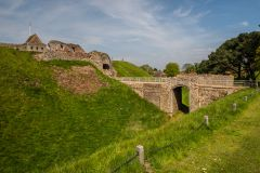 The earthwork defences and gatehouse bridge