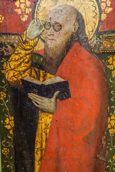 St Matthew with his spectacles on the 15th century screen
