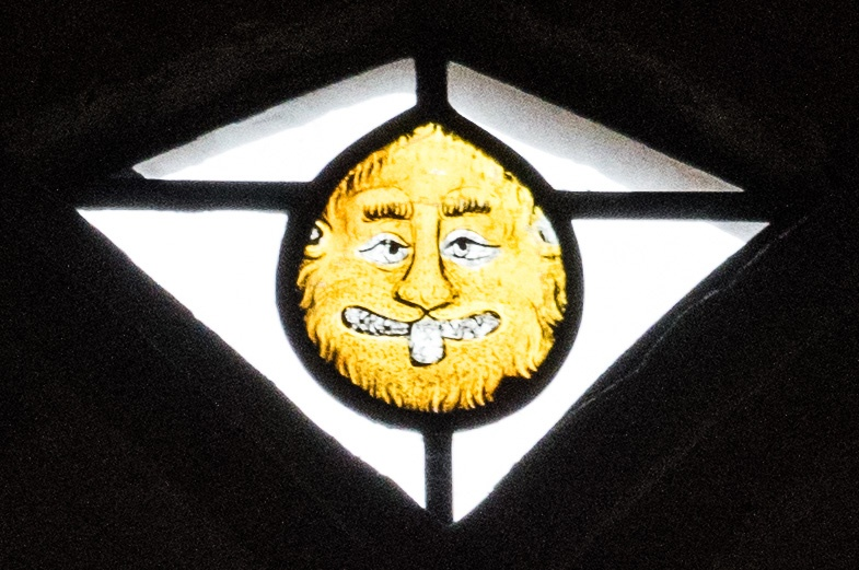 14th century stained glass of a lion's head