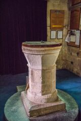 The plainly carved 12th century font