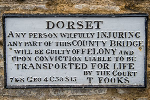 Charminster photo, An intriguing sign on the 19th century bridge beside the churchyard