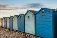 Charmouth, Colourful beach huts on the shingle