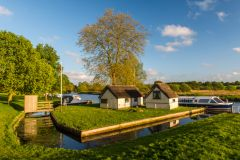 Coltishall, Boathouses on the River Bure at Coltishall Staithe