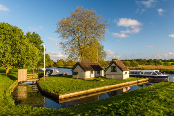 Coltishall photo, Boathouses on the River Bure at Coltishall Staithe