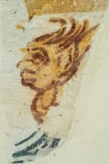 Wall painting of a face on the south nave wall