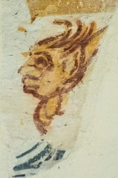 Wall Painting Of A Face On The South Nave