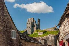 Corfe Castle village, The castle rises above the village rooftops