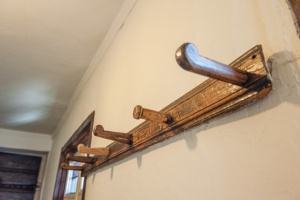 17th century hat pegs outside the schoolroom