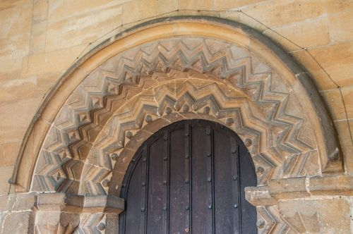 Cottesmore, St Nicholas Church photo, Norman decorative carving on the doorway arch