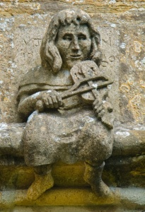 A 'hunky punk' or grotesque, depicting a man playing a fiddle