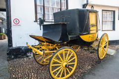 An ancient carriage outside the George Hotel