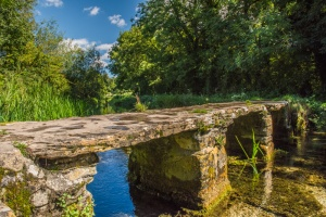 A picturesque clapper bridge over the River Leach