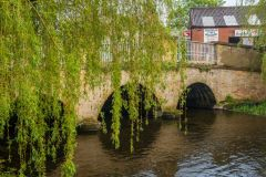 An old bridge across the Wensum on Bridge street