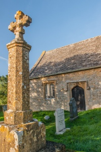 Churchyard memorial cross and south door