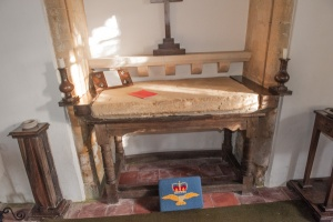 17th century communion table and 13th century altar slab