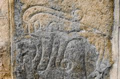 Carving of a beast, perhaps an elephant