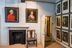 Paintings by Gainsborough line the walls