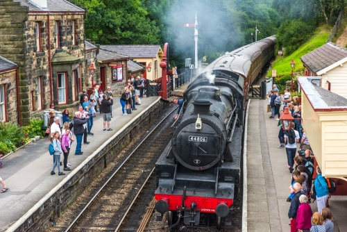 A steam train pulling into in Goathland rail station (Hogsmeade Station)