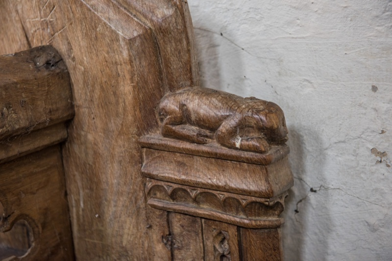 Medieval bench end carving of a dog