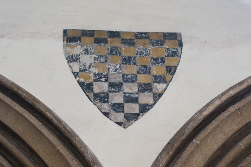 Painted coat of arms on the nave arcade