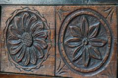 Panelling carvings of flowers