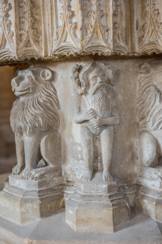 A woodwose and lions on the font base