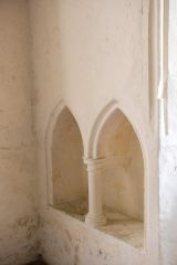 A double piscina in the chancel