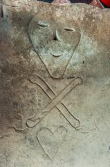 Holt, St Chad's Church, Momento mori carving on a 17th century grave slab