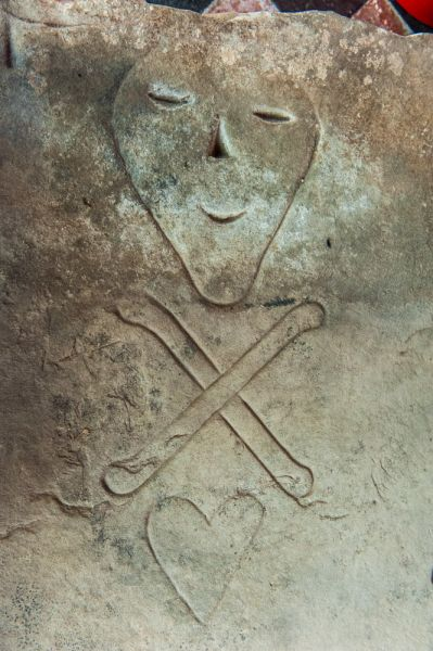 Holt, St Chad's Church photo, Momento mori carving on a 17th century grave slab