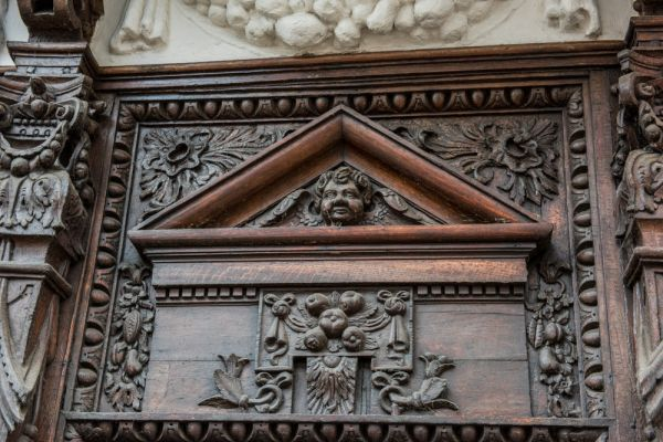 Ancient House photo, Richly detailed wood carving over the doorway