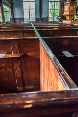 Looking along a row of 17th century pews