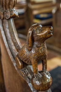Bench end depicting a dog