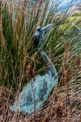 A heron sculpture beside the pool