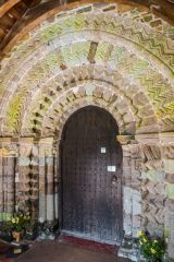 The beautifully carved south doorway arch