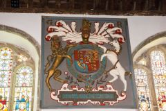 The ornately gilded royal coat of arms