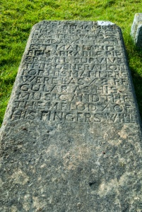 Grave slab of Charles MacArthur, the last hereditary piper of the Macdonalds of Duntulm