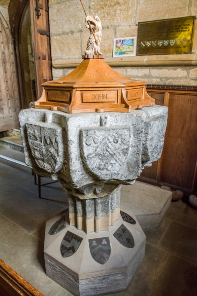 The ornately carved medieval font