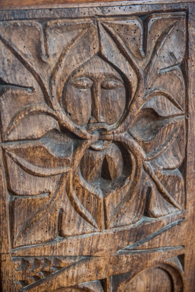 Green Man medieval bench end carving