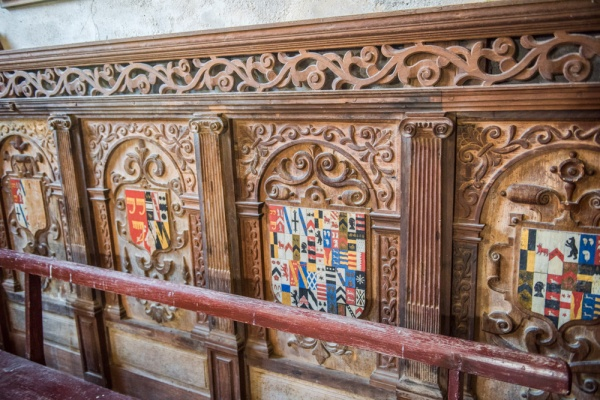 Carved panels from old family pews