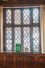 A mullioned window in the hall