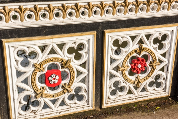 White and red roses decorate the railings