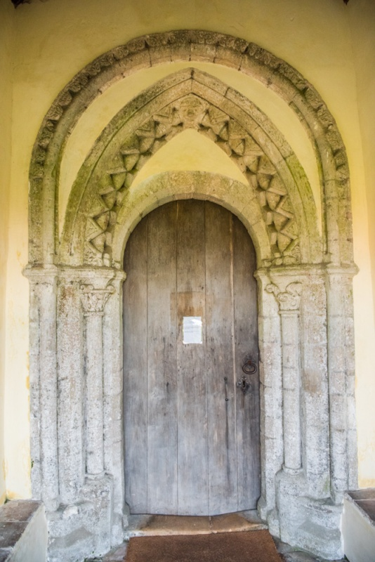 The unusual triple-arched doorway