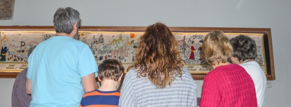 Visitors enjoying the Talking Tapestry