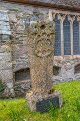 An ancient carved stone outside the church