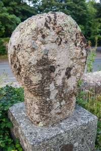 Worn Celtic cross in the churchyard
