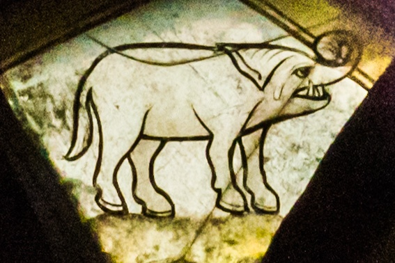 Medieval glass panel depicting a very fierce elephant