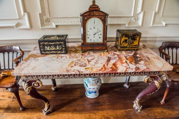Mompesson House photo, An ornate marble table in the entrance hall
