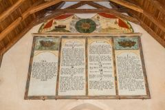 The richly painted Ten Commandments board