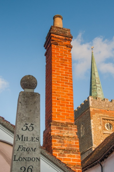 A picturesque  spire, chimney, and milestone